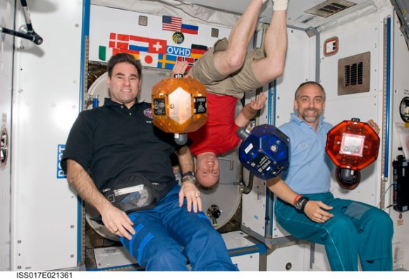 Astronauts Greg Chamitoff, Mike Fincke and spaceflight participant Richard Garriott posed with SPHERES.