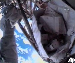 j Toolbag just out of the reach of Heide Stefanyshn-Piper.  Credit: AP/NASA TV
