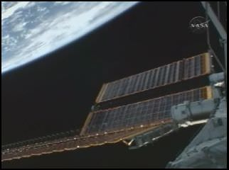 Screen shot from NASA TV during the solar array deployment. Credit: NASA TV