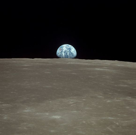 Earth rise over lunar surface. Credit: NASA