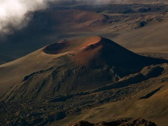Haleakal?, a giant shield volcano, forms the eastern bulwark of the island of Maui. Credit: National Geographic/Cathy Roberts