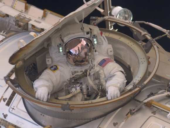 Astronaut Drew Feustel reenters the space station after completing an 8-hour, 7-minute spacewalk at on  Sunday, May 22, 2011. He and fellow spacewalker Mike Fincke conducted the second of the four EVAs during the STS-134 mission. Credit: NASA