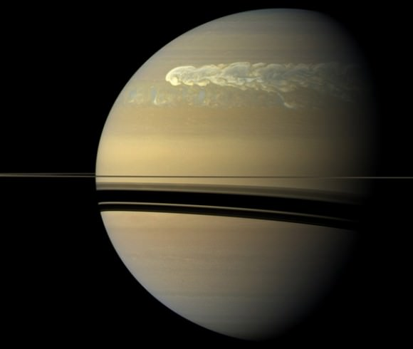 The huge storm churning through the atmosphere in Saturn's northern hemisphere overtakes itself as it encircles the planet in this true-color view from NASA's Cassini spacecraft. Image credit: NASA/JPL-Caltech/SSI