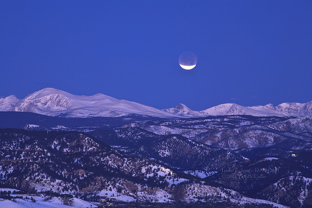 Indian Peaks in Colorado with the eclipsing Moon setting overhead. Credit: Patrick Cullis