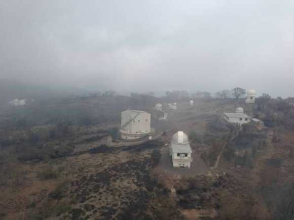 The Siding Springs Observatory after bush fires raged through the area. Photo by NSW Rural Fire Service.