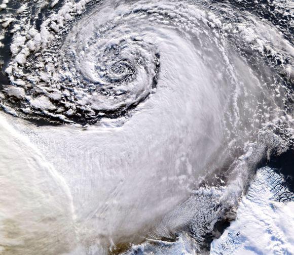 Satellite image of a cloud vortex off the coast of Greenland (NASA/MODIS/Chelys)