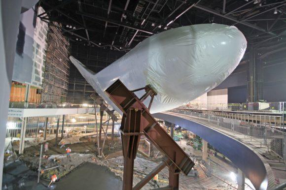 Shrink-wrapped Space Shuttle Atlantis inside museum home under construction at the Kennedy Space Center Visitor complex in Florida - mounted on pedestals.  Credit: Ken Kremer (kenkremer.com)