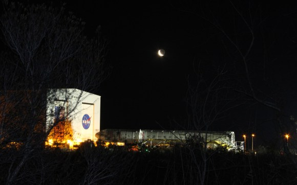 Antares rocket begins 1st ever rollout from processing hanger to NASA Wallops launch pad - beneath the Moon on 6 April 2013.  Credit: Ken Kremer (kenkremer.com)