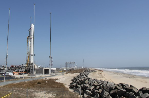 Antares rocket erect at the Eastern shore of Virginia slated for maiden liftoff on April 17.  Only a few hundred feet of beach sand and a miniscule sea wall separate the Wallops Island pad from the Atlantic Ocean waves and Mother Nature.  Credit: Ken Kremer (kenkremer.com)