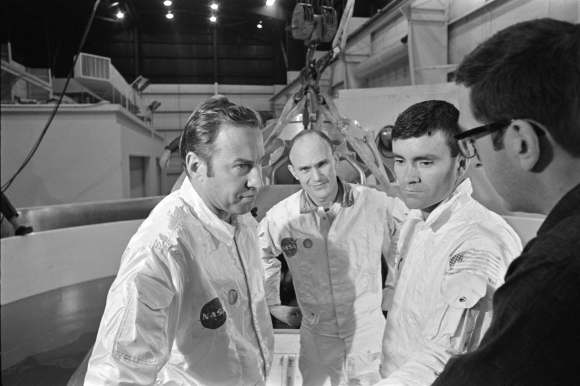 Apollo 13's original crew of Jim Lovell, Ken Mattingly and Fred Haise with an unidentified person. Credit: NASA