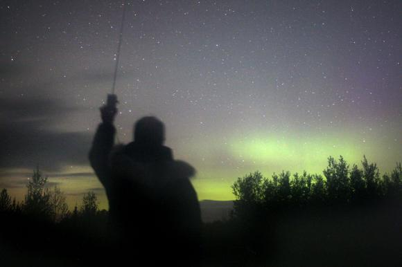 A rural location is ideal for listening to the subtle sounds of the aurora with a VLF radio. Just turn it on and hold it up to the sky.This photo was taken early Saturday morning when green auroras were still visible through breaks in the clouds. Photo: Bob King