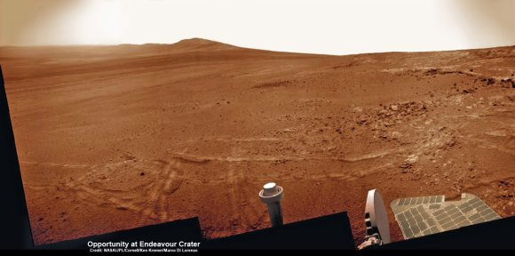 Opportunity established a new American driving record for a vehicle on another world on May 15, 2013 (Sol 3309) and made history by driving ahead from this point at Cape York. This navcam mosaic shows the view forward to her next destinations of Solander Point and Cape Tribulation along the lengthy rim of huge Endeavour crater spanning 14 miles (22 km) in diameter.  Opportunity discovered clay minerals at Cape York and stands as the most favorable location for Martian biology discovered during her entire nearly 10 year long mission to Mars.  Credit: NASA/JPL/Cornell/Kenneth Kremer/Marco Di Lorenzo