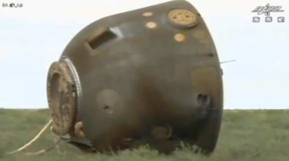 Screenshot showing the Shenzou-10 capsule on the ground following a successful mission for China.