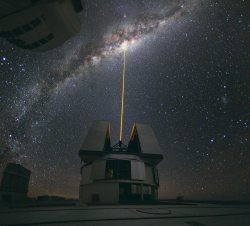 A beam from the Laser Star Guide on one of the VLT's four Unit Telescopes helps to correct the blurring effect of Earth's atmosphere before making observations (ESO/Y. Beletsky)