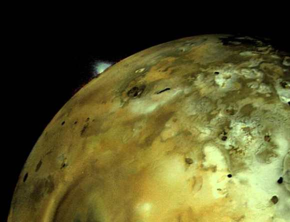 Voyager 1 acquired this image of Io on March 4, 1979. An enormous volcanic explosion can be seen silhouetted against dark space over Io's bright limb. Credit: NASA/JPL.