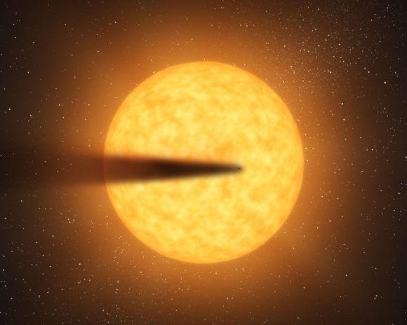 An artist's conception of a disintegrating planet - creating a trail of dust - around its rocky star.