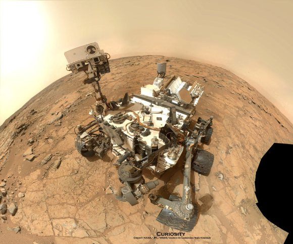 NASA's Mars rover Curiosity took this self-portrait, composed of more than 50 images using its robotic arm-mounted MAHLI camera, on Feb. 3, 2013. The image shows Curiosity at the John Klein drill site. A drill hole is visible at bottom left.  Credit: NASA / JPL / MSSS / Marco Di Lorenzo / Ken Kremer- kenkremer.com