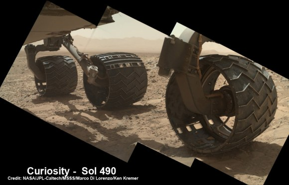 Photomosaic shows new holes and tears in several of rover Curiosity's six wheels caused by recent driving over sharp edged Martian rocks on the months long trek to Mount Sharp. Raw images taken by the MAHLI camera on Curiosity's arm on Dec. 22, 2013 (Sol 490) were assembled to show some recent damage to several of its six wheels – most noticeably the two here in middle and front. Credit: NASA / JPL / MSSS / Marco Di Lorenzo / Ken Kremer- kenkremer.com See below complete 6 wheel mosaic and further wheel mosaics for comparison