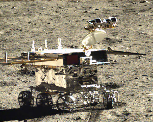 Yutu rover points mast with cameras and high gain antenna to inspect lunar soil around landing site in this photo taken by Chang'e-3 lander. Credit: CNSA