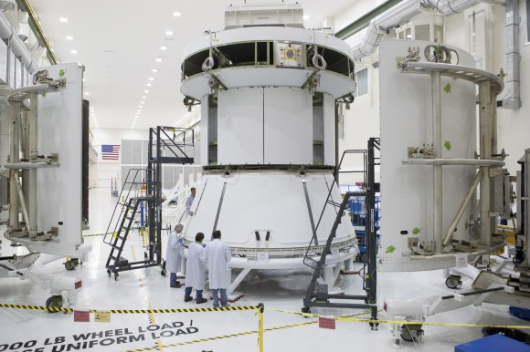 Engineers prepare Orion's service module for installation of the fairings that will protect it during launch this fall when Orion launches on its first mission. The service module, along with its fairings, is now complete.  Credit:  NASA
