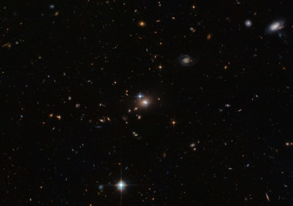 The quasar QSO 0957+561 appears twice in the center of this image due to a phenomenon known as gravitational lensing, which takes place when light bends around another (massive) object. Credit: ESA/NASA