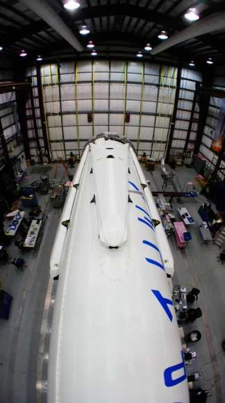 All four landing legs now mounted on Falcon 9 rocket being processed inside hanger at Cape Canaveral, FL for Mar 16 launch.  Credit: SpaceX/Elon Musk