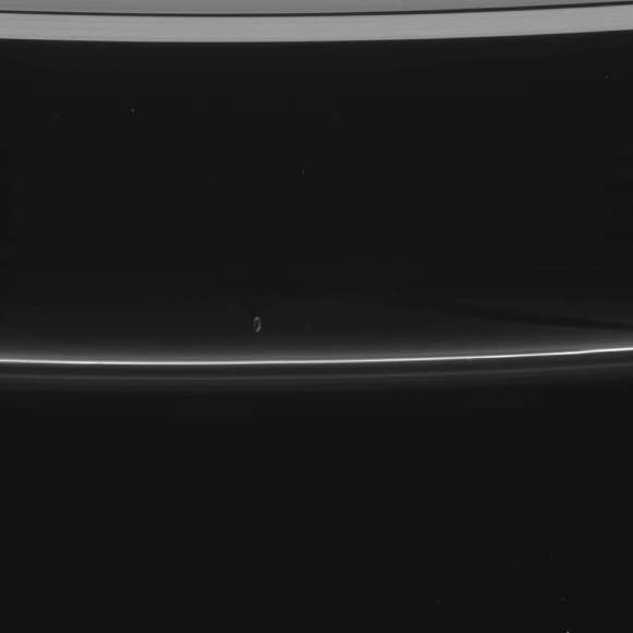 Shepherd moon Prometheus hovers just inside the reflective F ring