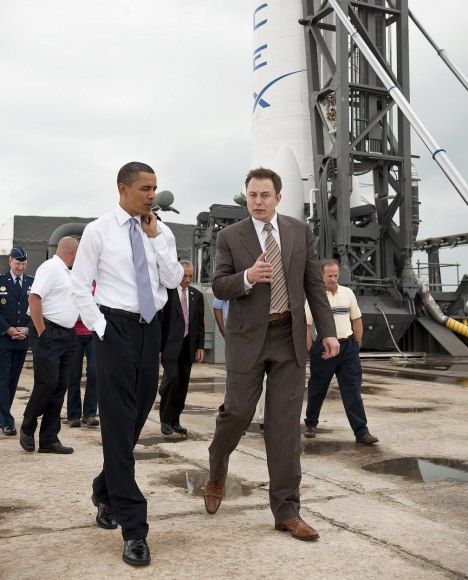 U.S. president Barack Obama (foreground, left) with SpaceX CEO Elon Musk during a 2010 tour at the Kennedy Space Center in Florida. (Credit: Chuck Kennedy)