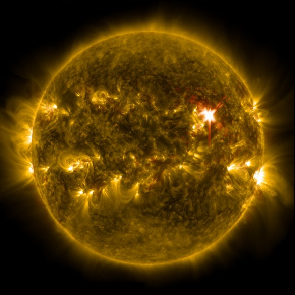 Extreme ultraviolet light streams out of an X-class solar flare as seen in this image captured on Marc