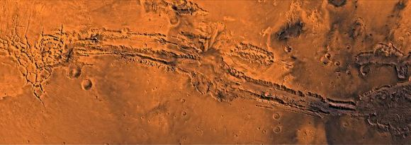 Valles Marineris as seen in this mosaic of Viking orbiter images. Noctis Labyrinthus at the left, Melas Chasma in the middle, Hebes Chasma just left of top center, Eos Chasma at lower right and Ganges Chasma just above center right. Credit: NASA/JPL
