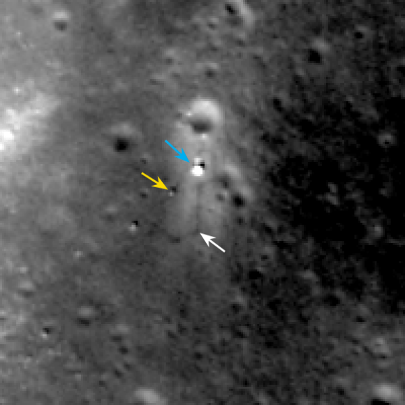 LROC February 2014 image of Chang'e 3 site. Blue arrow indicates Chang'e 3 lander; yellow arrow points to Yutu (rover); and white arrow marks the December location of Yutu. Yutu's tracks can be followed clockwise around the lander to its current location. Image width 200 meters (about 656 feet).  Credit:  NASA/Goddard