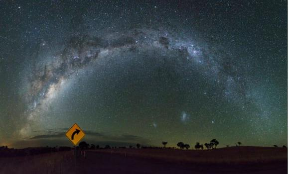 A 14-image panorama of the Milky Way taken under very dark skies in the heart of the Riverina, New South Wales, Australia, with a bit of direction from a road sign. Credit and copyright: Carlos Orue.