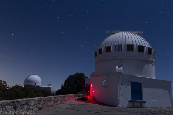 Mars and Spica rising over the telescope domes at Kitt Peak, Arizona. The 2.1 metre dome is on the left, and the 0.9 metre dome is to the right. Credit-Rob Sparks @halfastro