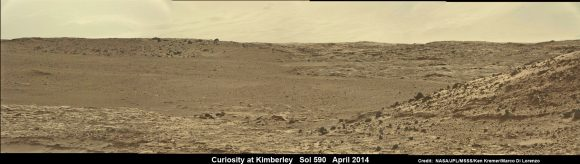 Curiosity scans scientifically intriguing rock outcrops of Martian terrain at 'The Kimberley' waypoint in search of next drilling location, beside low hill at right.  Mastcam color photomosaic assembled from raw images snapped on Sol 590, April 4, 2014. Credit: NASA/JPL/MSSS/Ken Kremer - kenkremer.com/Marco Di Lorenzo