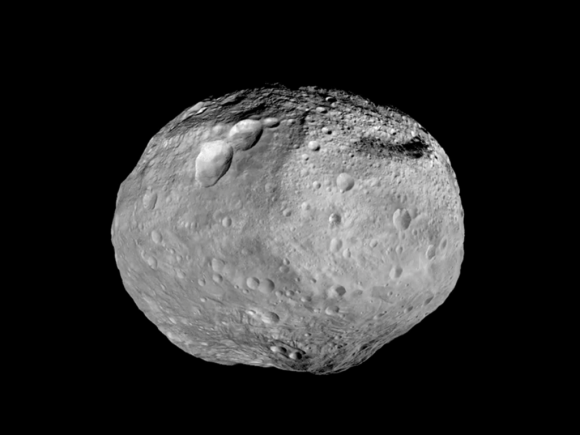 "Mosaic synthesizes some of the best views the spacecraft had of the giant asteroid Vesta. Dawn studied Vesta. The towering mountain at the south pole - more than twice the height of Mount Everest - is visible at the bottom of the image. The set of three craters known as the ""snowman"" can be seen at the top left. Credit: NASA/JPL-Caltech/UCAL/MPS/DLR/IDA"