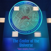 """This 16-inch-wide plaque is set into the floor of the """"dark room"""" at JPL Mission Control, covered by a pane of clear acrylic. (J. Major)"""