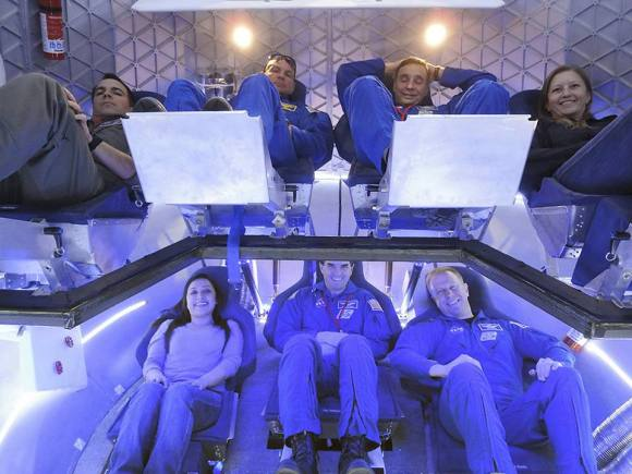 NASA astronauts and industry experts check out the crew accommodations in the Dragon spacecraft under development by SpaceX. The evaluation in Hawthorne, Calif., on Jan. 30, 2012, was part of SpaceX's Commercial Crew Development Rou