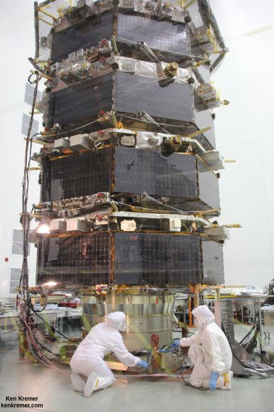 Technicians work on NASA's 20-foot-tall Magnetospheric Multiscale (MMS) mated quartet of stacked observatories in the cleanroom at NASA's Goddard Space Flight Center in Greenbelt, Md., on May 12, 2014.  Credit: Ken Kremer- kenkremer.com