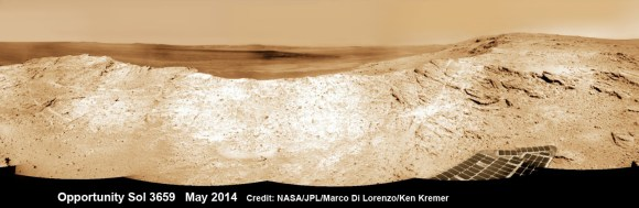 NASA's Opportunity Mars rover captures sweeping panoramic vista near the ridgeline of 22 km (14 mi) wide Endeavour Crater's western rim. The center is southeastward and the distant rim is visible in the center.  See the complete panorama below showing an outcrop area targeted for the rover to study. This navcam panoram was stitched from images taken on May 10, 2014 (Sol 3659) and colorized.  Credit: NASA/JPL/Cornell/Marco Di Lorenzo/Ken Kremer-kenkremer.com