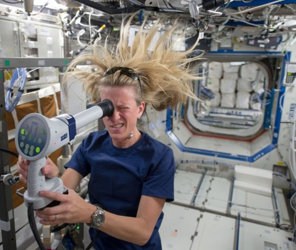 Expedition 36/37 astronaut Karen Nyberg uses a fundoscope to take still and video images of her eye while in orbit. Credit: NASA