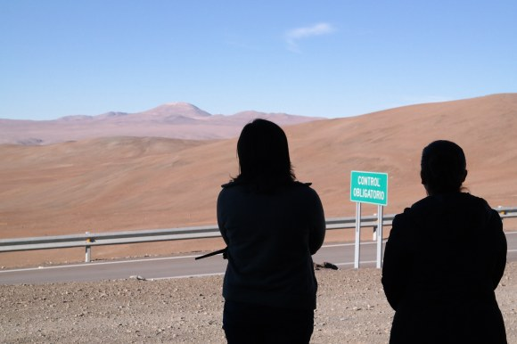 The set-up crew for the E-ELT blast looks at Cerro Armazones. Credit: ESO