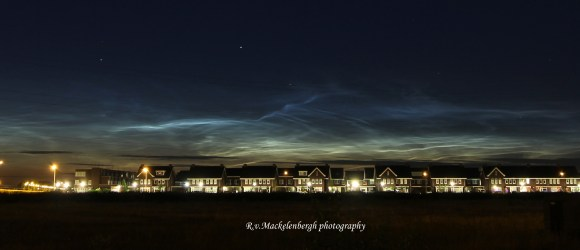 Noctilucent clouds over the city of Rosmalen, Holland, July 3, 2014. Taken with Canon 60D, 28 mm lens. Credit: Rob van Mackelenbergh