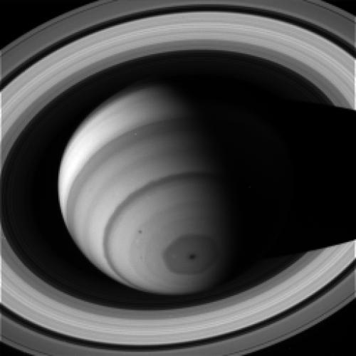 A hexagonal storm on Saturn rages in this image tak