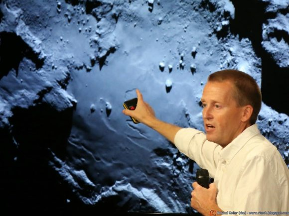 Holger Sierks, OSIRIS principal investigator, discusses spectacular hi res comet images returned so far by Rosetta during the Aug. 6 ESA webcast from mission control at ESOC, Darmstadt, Germany. Credit: Roland Keller