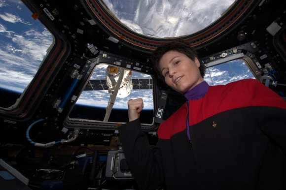 """""""There's coffee in that nebula""""... ehm, I mean... in that #Dragon.  Engineer Samantha Cristoforetti of the European Space Agency in Star Trek uniform as Dragon arrives at the International Space Station on April 17, 2015. Credit: NASA"""