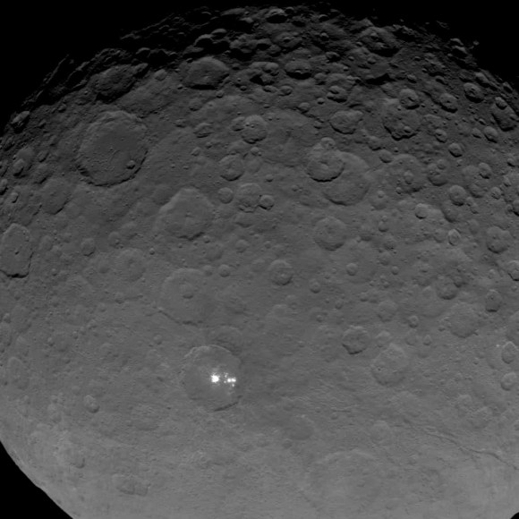 Latest image released by NASA of the spatter of white spots in the 57-mile-wide crater on the dwarf planet Ceres. Scientists with the Dawn mission believe they're highly reflective material, likely ice. Credit: NASA/JPL-Caltech/UCLA/MPS/DLR/IDA