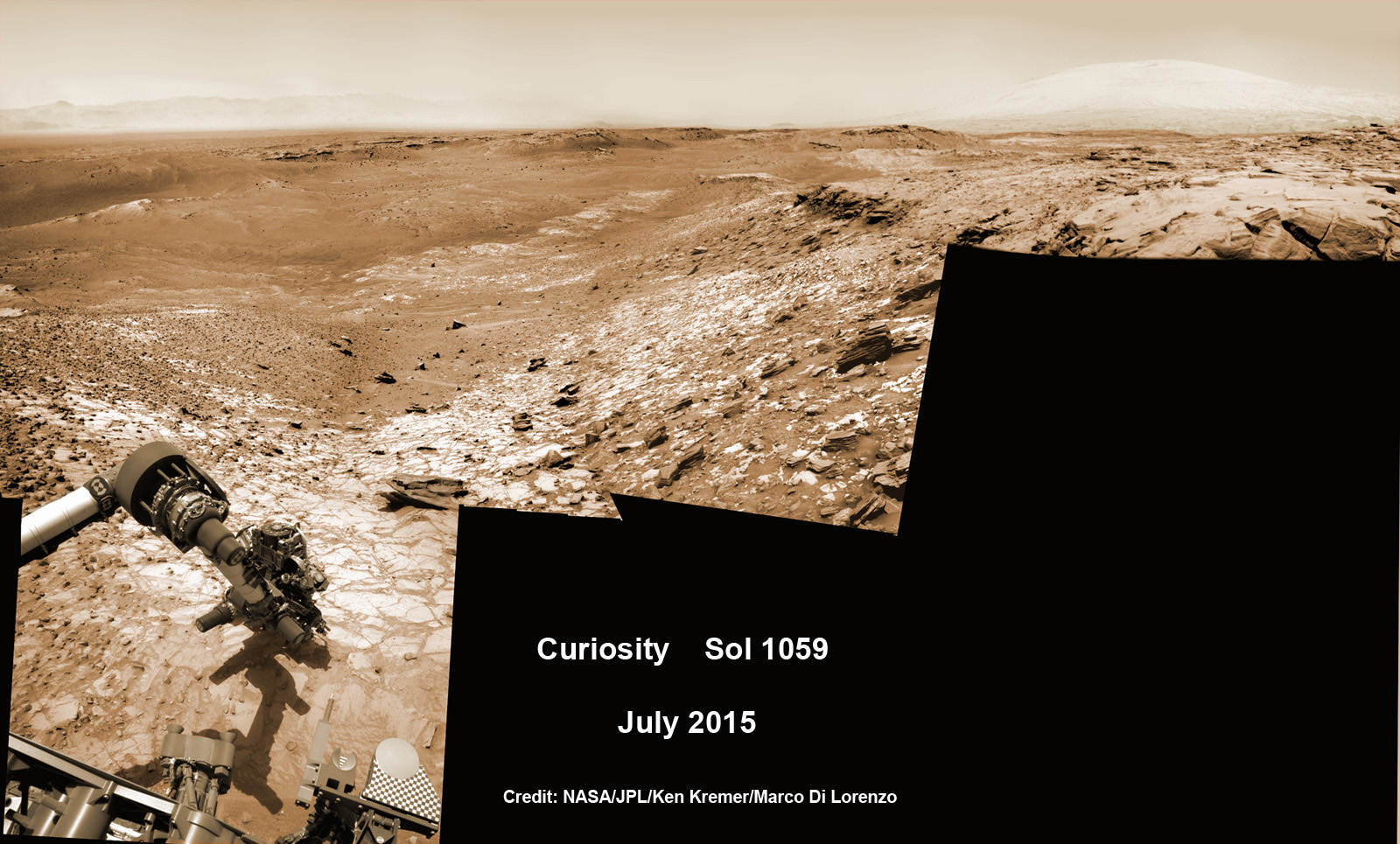 "Curiosity conducts test drill at ""Buckskin"" rock target at bright toned ""Lion"" outcrop on the lower region of Mount Sharp on Mars, seen at right.   Gale Crater eroded rim seen in the distant background at left, in this composite multisol mosaic of navcam raw images taken to Sol 1059, July 30, 2015.  Navcam camera raw images stitched and colorized. Credit:  NASA/JPL-Caltech/Ken Kremer/kenkremer.com/Marco Di Lorenzo"