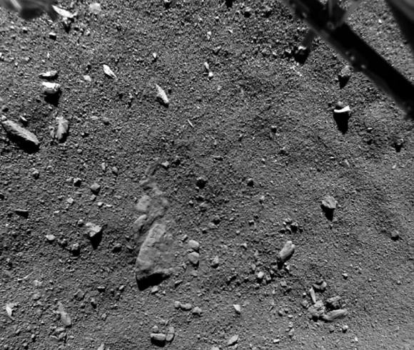 We've never seen a comet as close as this. Taken shortly before touchdown by the Philae lander on November 12, 2014, you're looking across a scene just 32 feet from side to side (9.7-meters) or about the size of a living room. Part of the lander is visible at upper right. Credit: ESA/Rosetta/Philae/ROLIS/DLR