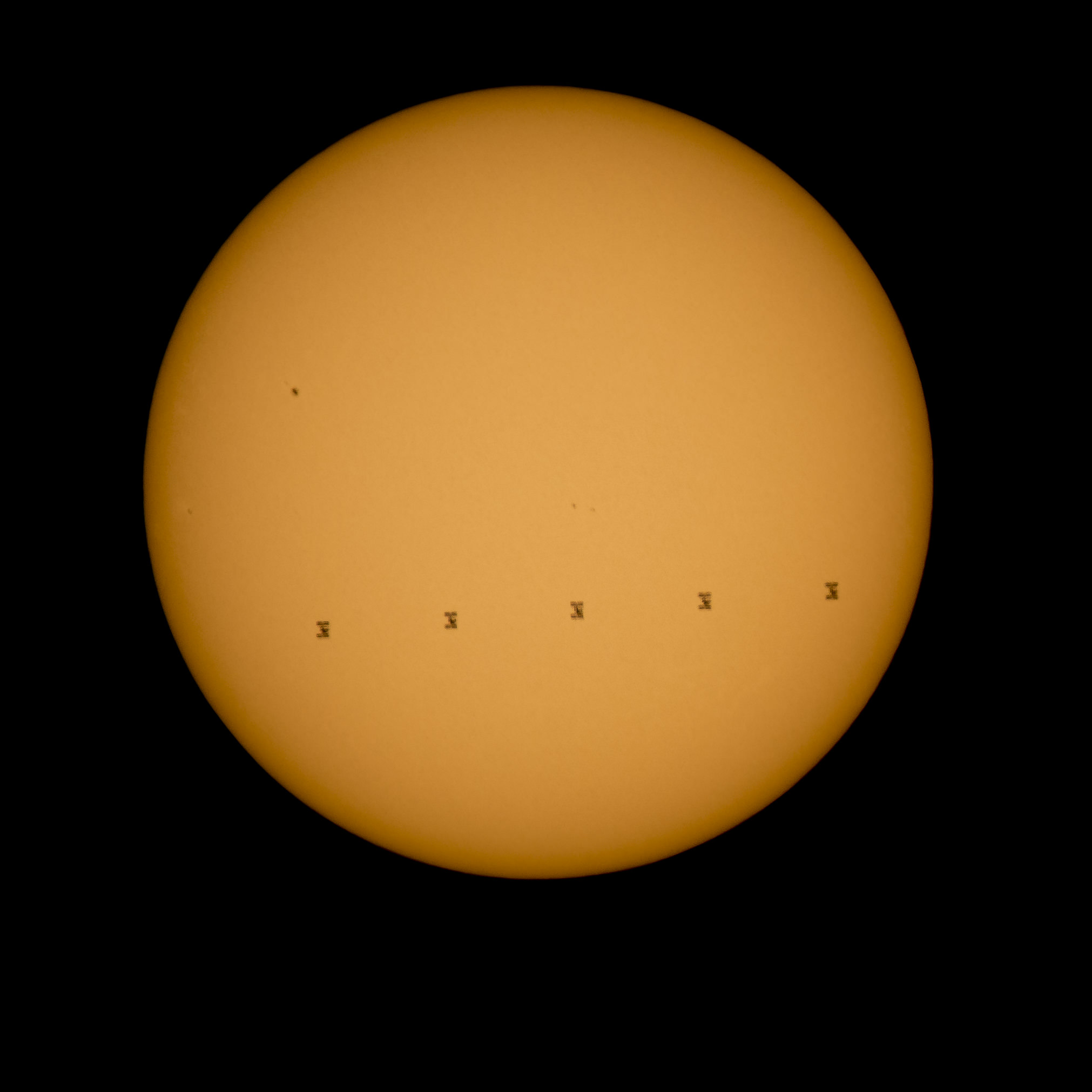 The International Space Station transits the sun on Sunday, Sept. 6, 2015 with an enhanced crew of nine, as seen from Shenandoah National Park, Front Royal, VA in this composite image by NASA photographer Bill Ingalls.  Credit: NASA/Bill Ingalls