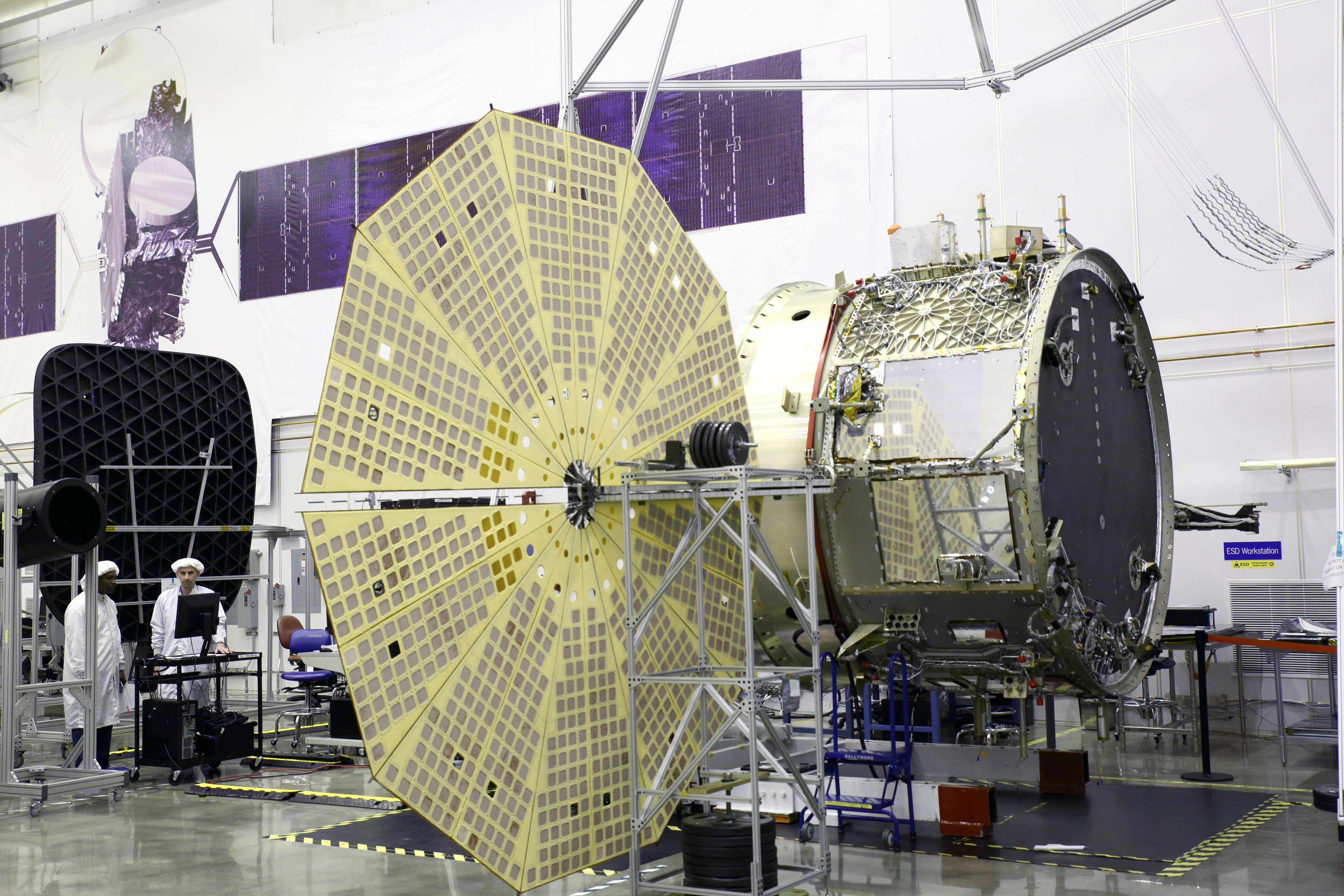 Cygnus service module built by Orbital ATK in their Dulles, Virginia cleanroom is shown here with unfurled Ultraflex solar panels that will fly for the first time with mated pressurized module on the OA-4 ISS resupply mission on ULA Atlas V rocket on Dec. 3, 2015 from Cape Canaveral, Florida.    Credit: Orbital ATK